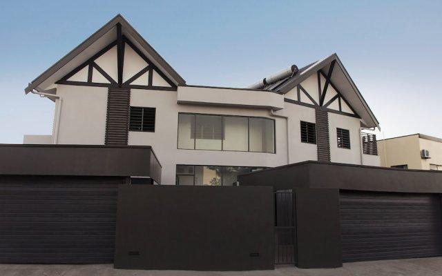 Апартаменты GreyStone Apartments 03 вид на фасад
