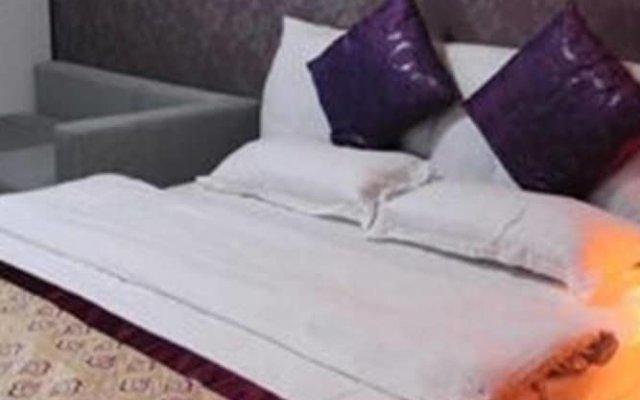Отель Dihao Holiday Apartment Hotel Китай, Сиань - отзывы, цены и фото номеров - забронировать отель Dihao Holiday Apartment Hotel онлайн комната для гостей
