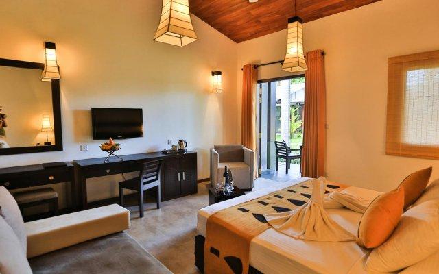 Отель Chaarya Resort & Spa By Chandrika Hotels комната для гостей
