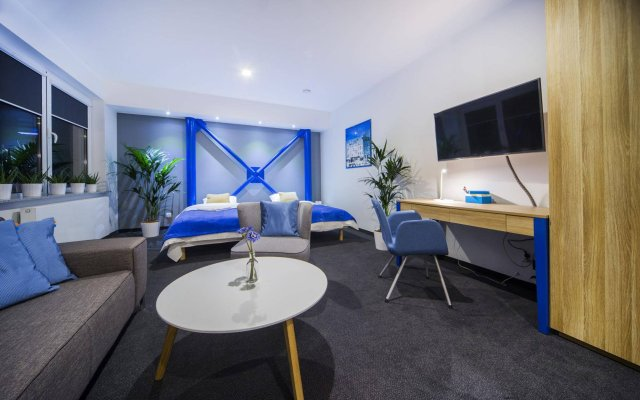 Апартаменты Mosquito Silesia Apartments Катовице комната для гостей