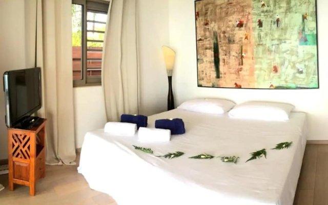 Отель Villa Vahineria 9pax Французская Полинезия, Пунаауиа - отзывы, цены и фото номеров - забронировать отель Villa Vahineria 9pax онлайн комната для гостей