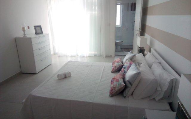 Апартаменты The Edge Apartment комната для гостей