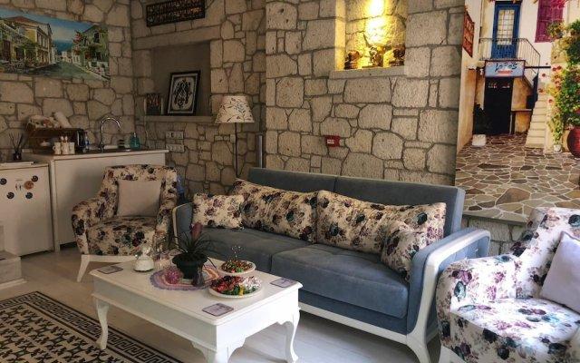Отель Lodos Butik Otel Чешме комната для гостей