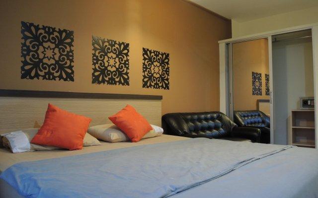 Отель Chitra Suite Паттайя комната для гостей