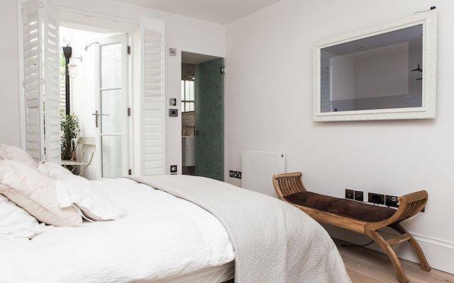 Отель Stylish 2 Bedroom Garden Apartment in Notting Hill Великобритания, Лондон - отзывы, цены и фото номеров - забронировать отель Stylish 2 Bedroom Garden Apartment in Notting Hill онлайн комната для гостей