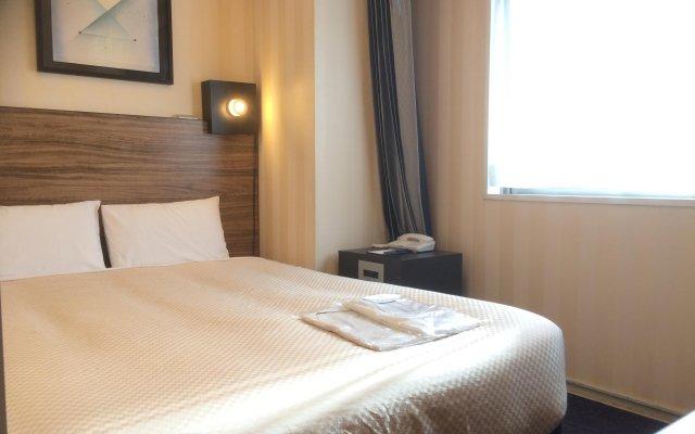 Отель Villa Fontaine Nihombashi Hakozaki Токио комната для гостей