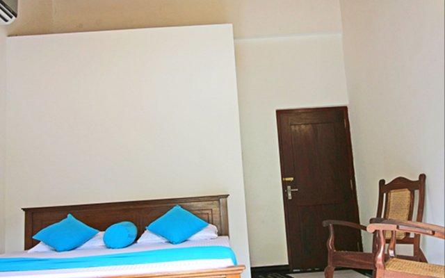 Отель Bentota Beach by Cinnamon Шри-Ланка, Бентота - отзывы, цены и фото номеров - забронировать отель Bentota Beach by Cinnamon онлайн комната для гостей