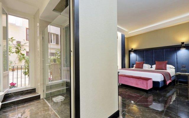 Отель Merulana 13 - Exclusive Rooms комната для гостей