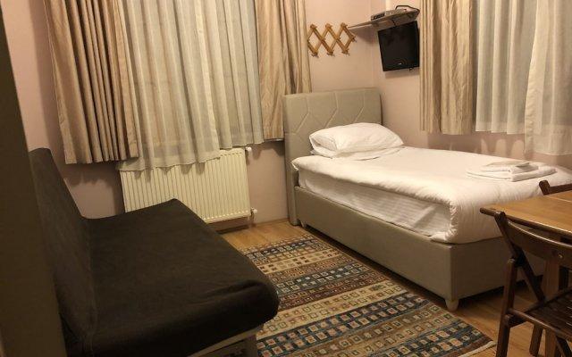 Апартаменты Topkapi Apartments Стамбул комната для гостей