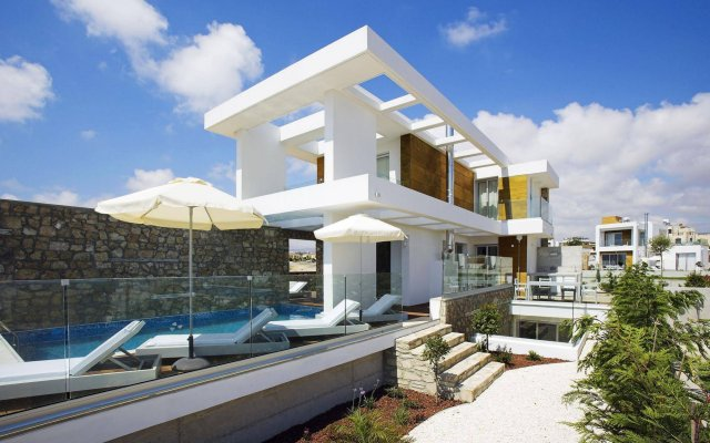 Отель Paradise Cove Luxurious Beach Villas Кипр, Пафос - отзывы, цены и фото номеров - забронировать отель Paradise Cove Luxurious Beach Villas онлайн вид на фасад