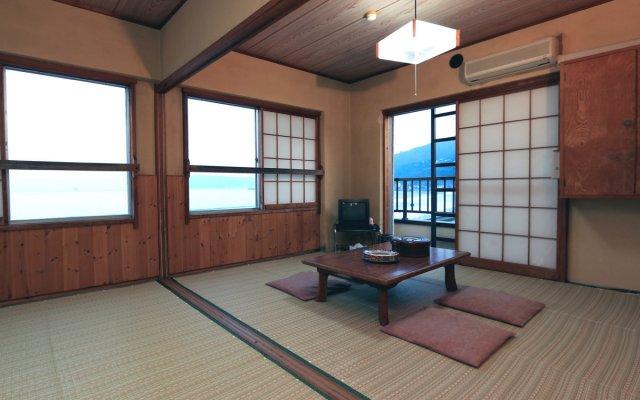 Отель Usami Onsen Fugu Jizakana Ryori no Yado Otsuka Ито комната для гостей