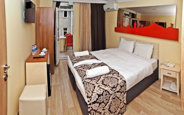The Queen Hotel комната для гостей