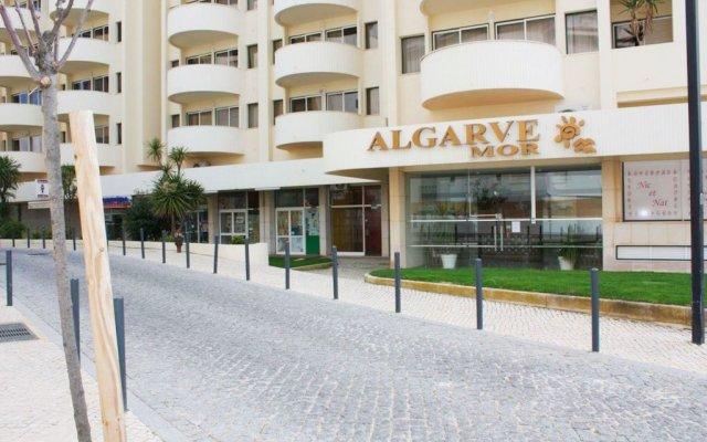 Отель Apartamentos Turisticos Algarve Mor Португалия, Портимао - отзывы, цены и фото номеров - забронировать отель Apartamentos Turisticos Algarve Mor онлайн вид на фасад