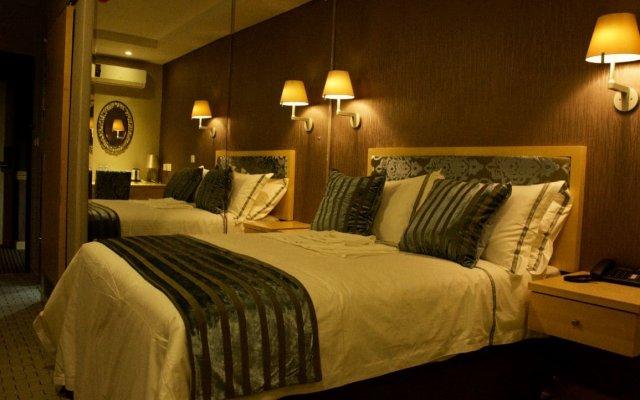 Отель Aquarian Tide Габороне комната для гостей