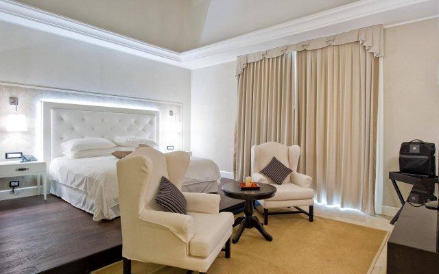 Отель I Monasteri Golf Resort Сиракуза комната для гостей