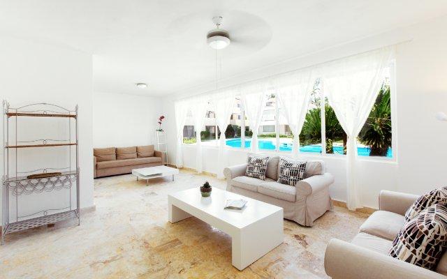 Отель Los Corales Villas & Apartments Доминикана, Пунта Кана - отзывы, цены и фото номеров - забронировать отель Los Corales Villas & Apartments онлайн комната для гостей