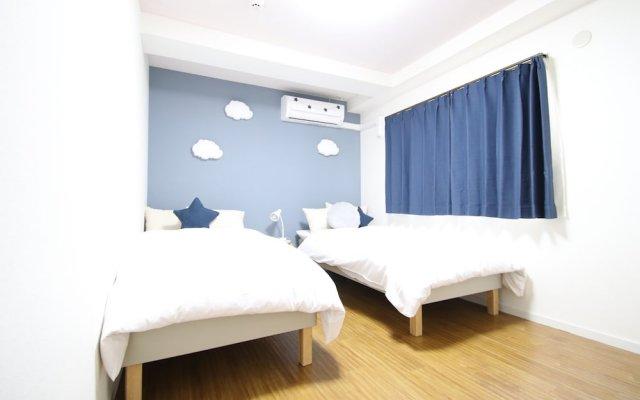 Отель AMP FLAT Nishijin5 Фукуока комната для гостей