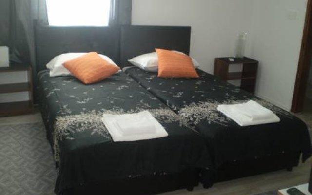 Отель Zenovic House Будва комната для гостей