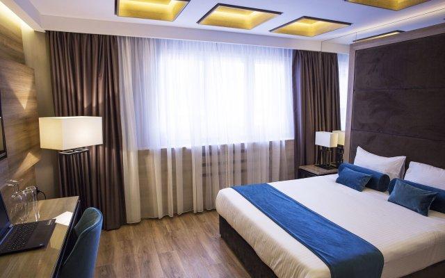 Отель Eden Luxury Suites Terazije комната для гостей