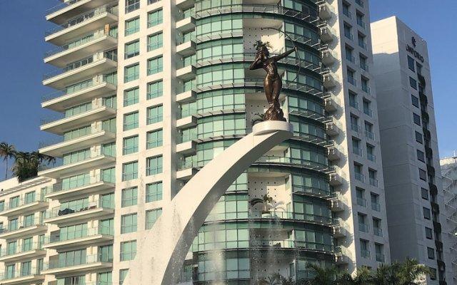 Отель Playa Suites вид на фасад
