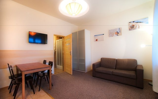 Отель Apartamenty Dobranoc - Ul. Storczykowa Варшава комната для гостей