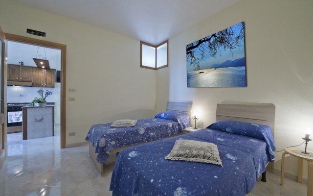 Отель Colle Sant'Angelo Аджерола комната для гостей