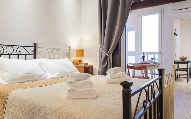 Апартаменты Santa Croce Apartment Флоренция комната для гостей