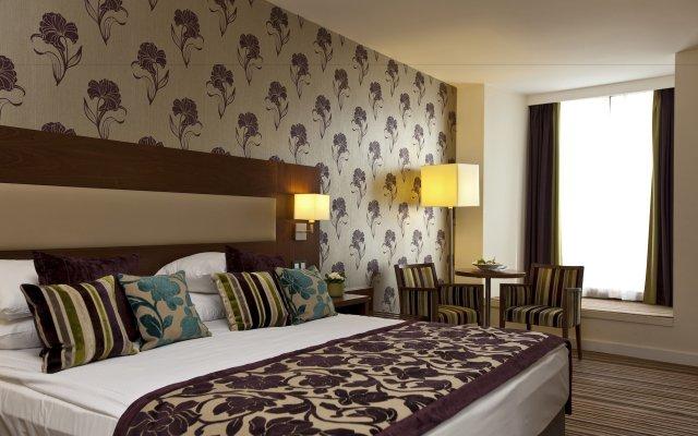 Отель Ramada Plaza Liege City Center Льеж комната для гостей