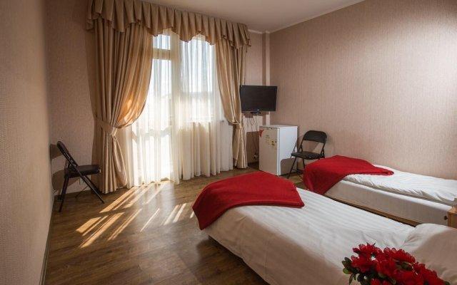 Гостиница Olympic House комната для гостей