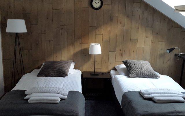 Гостиница «PEOPLE LOFT TVERSKAYA» Индивидуального предпринимателя Разинкина Сергея Сергеевича комната для гостей