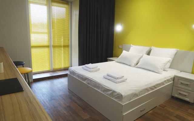 Апартаменты КвартХаус комната для гостей