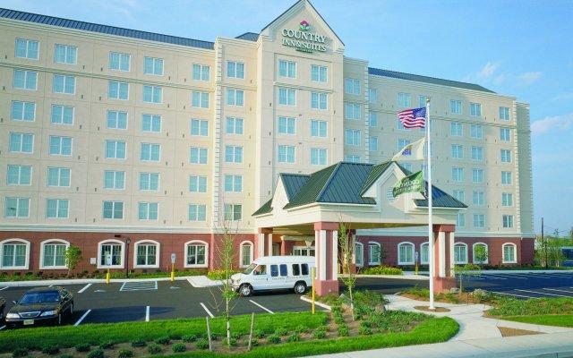 Отель Country Inn & Suites by Radisson, Newark Airport, NJ США, Элизабет - отзывы, цены и фото номеров - забронировать отель Country Inn & Suites by Radisson, Newark Airport, NJ онлайн крыльцо