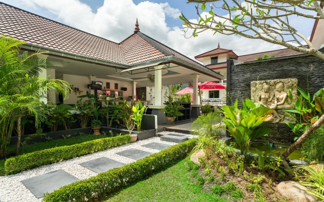 Отель Tropical Palm Resort Самуи сад