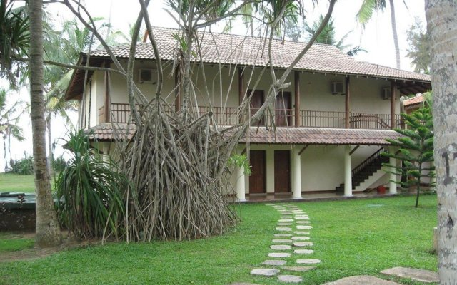 Отель Kosgoda Beach Resort Шри-Ланка, Косгода - отзывы, цены и фото номеров - забронировать отель Kosgoda Beach Resort онлайн вид на фасад