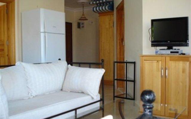 Deniz Apartment Турция, Калкан - отзывы, цены и фото номеров - забронировать отель Deniz Apartment онлайн комната для гостей