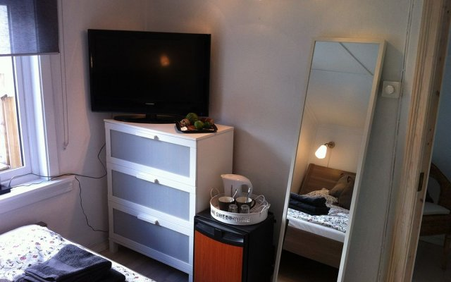 Апартаменты Bergen Apartments Берген комната для гостей