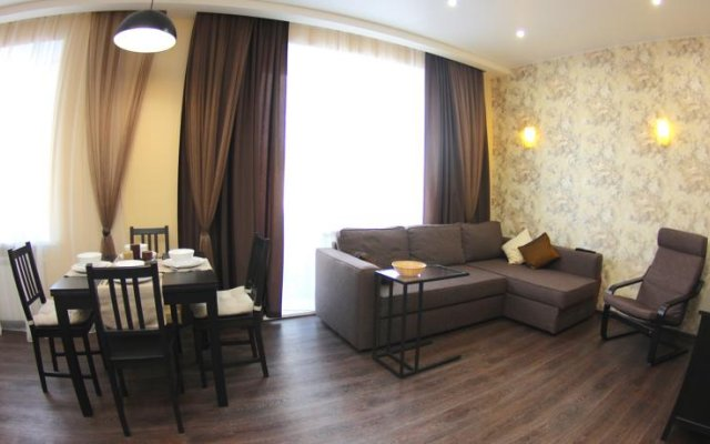 Апартаменты «Альфа на Маркса» Омск комната для гостей