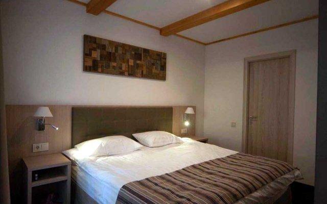 Гостиница Arkhyz Royal Resort & Spa в Архызе отзывы, цены и фото номеров - забронировать гостиницу Arkhyz Royal Resort & Spa онлайн Архыз комната для гостей
