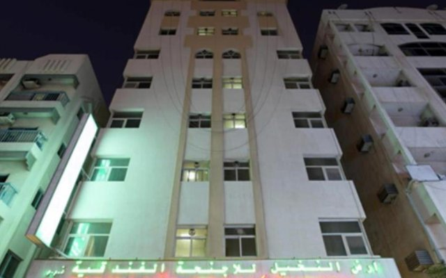 Palmland Hotel Suites вид на фасад