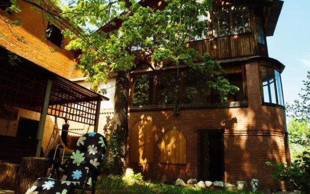 Гостиница Коттеджи в Самаре Домик в Деревне 37 вид на фасад