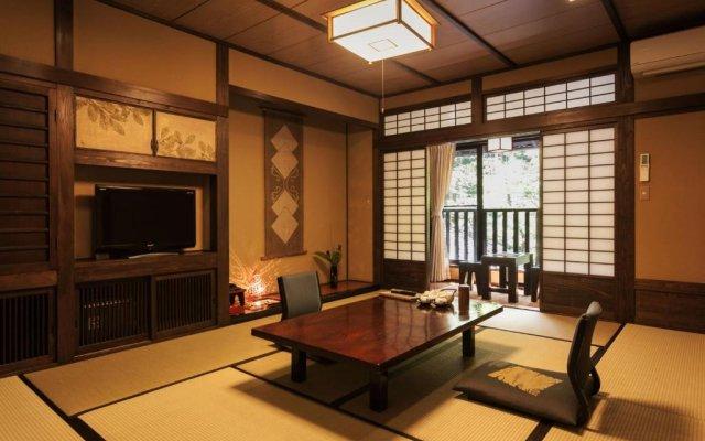 Отель Sanga Ryokan Минамиогуни комната для гостей