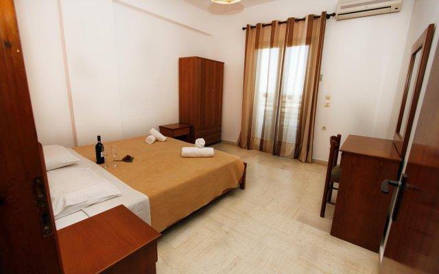 Апартаменты Lofos Apartments комната для гостей