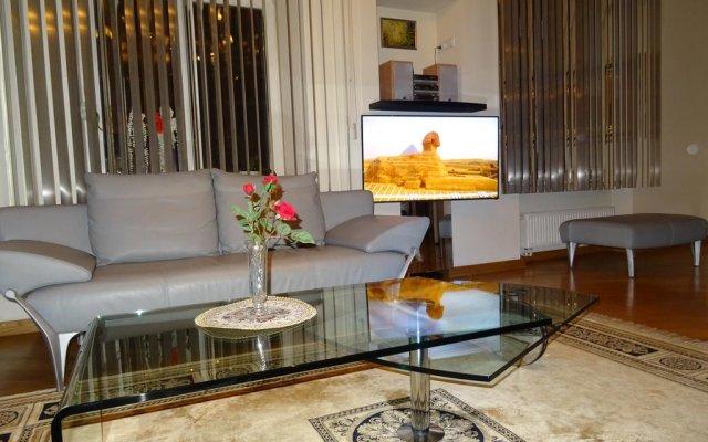Отель Pilies Avenue Apartment Литва, Вильнюс - отзывы, цены и фото номеров - забронировать отель Pilies Avenue Apartment онлайн комната для гостей