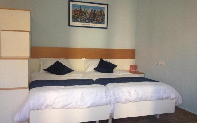 Отель EasyStay Studios комната для гостей
