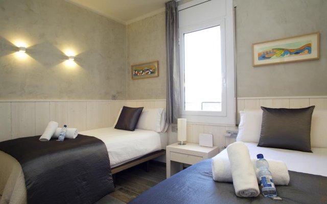 Отель Barcelonaforrent Market Suites Барселона комната для гостей