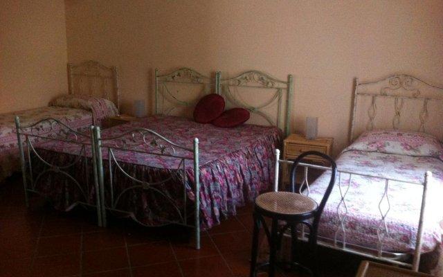 Отель La Dimora Dei 5 Sensi Понтеканьяно-Фаяно комната для гостей