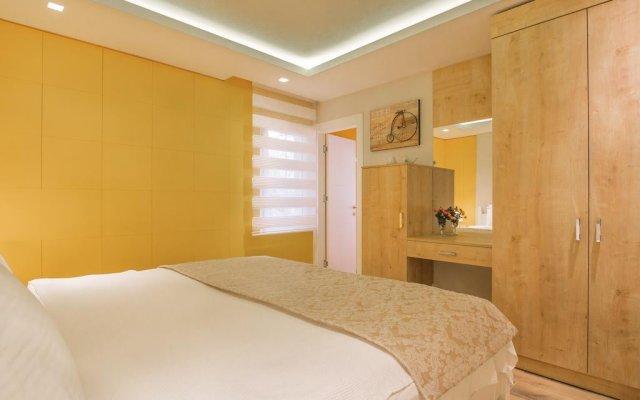 Отель Garden Suites комната для гостей