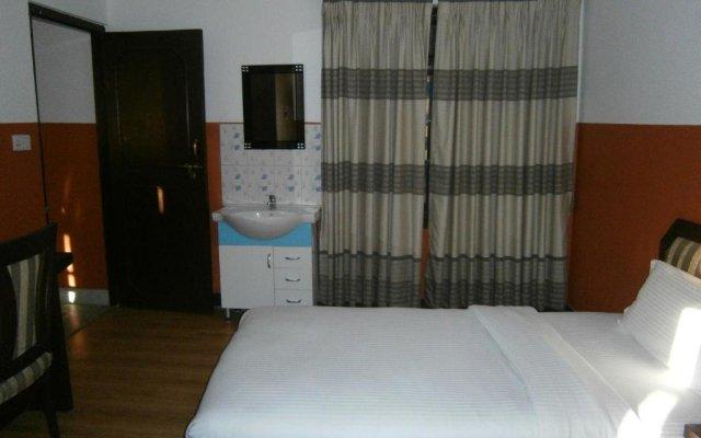 Отель Nepal Apartment Непал, Катманду - отзывы, цены и фото номеров - забронировать отель Nepal Apartment онлайн комната для гостей