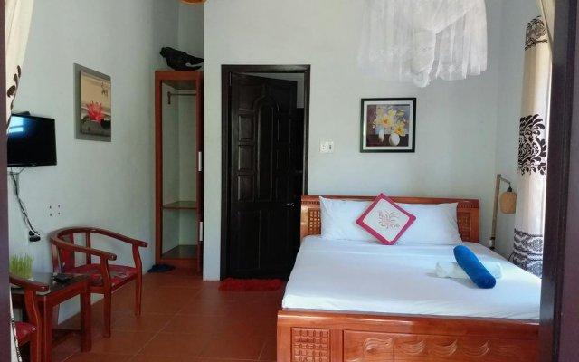 Отель Dragon Sea Homestay Хойан комната для гостей