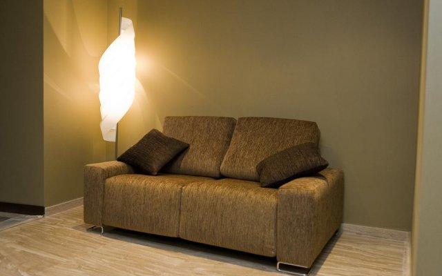 Отель Apartamentos Conilsol Испания, Кониль-де-ла-Фронтера - отзывы, цены и фото номеров - забронировать отель Apartamentos Conilsol онлайн комната для гостей